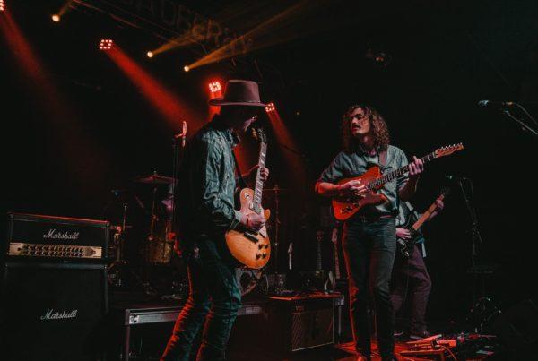 group of men playing guitars